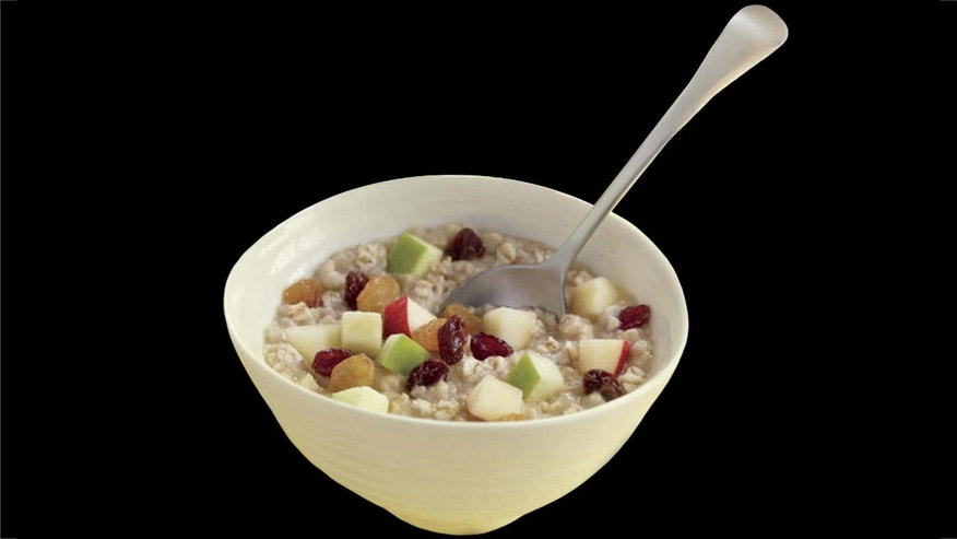 Taste the sweet harmony of flavors in McDonald's new Fruit & Maple Oatmeal, prepared with 100 percent natural whole grain oats, light cream and brown sugar, and topped with diced, fresh red and green apples, tangy dried cranberries and two types of raisins. Available any time of the day, Fruit & Maple Oatmeal is available with or without brown sugar.  (PRNewsFoto/McDonald's) THIS CONTENT IS PROVIDED BY PRNewsfoto and is for EDITORIAL USE ONLY**