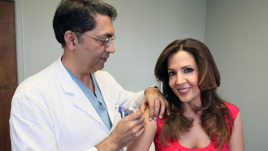 Maria Canals Barrera gets vaccinated in time for flu season.