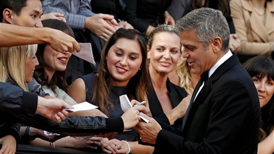 George Clooney arrives before the 84th Academy Awards on Sunday, Feb. 26, 2012, in the Hollywood section of Los Angeles. (AP Photo/Matt Sayles)