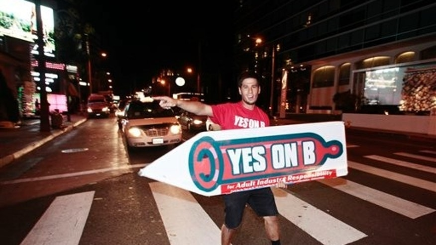 Supporters of Vote Yes on B in Los Angeles handed out voter information and free condoms on Sunset Strip.