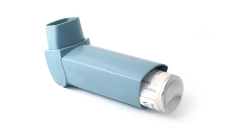 Asthma inhaler isolated on white