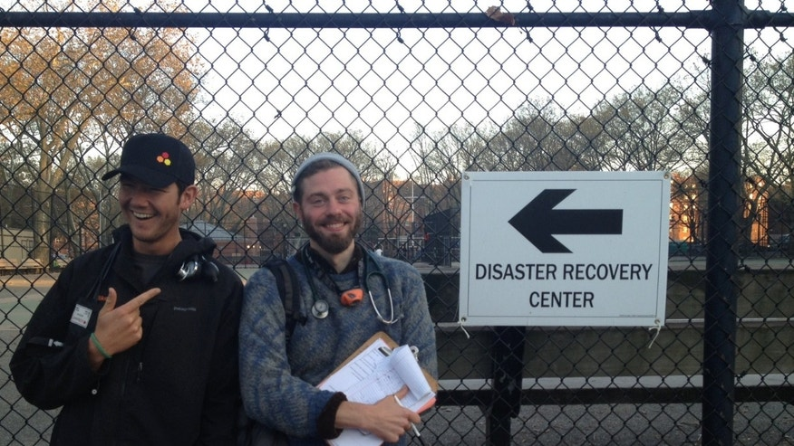 Matthew Kraushar (center) in Red Hook while looking for sick patients in the Brooklyn neighborhood