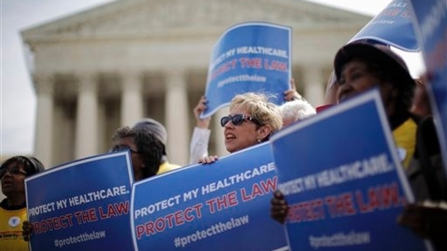 Supporters of health care reform rally in front of the Supreme Court.