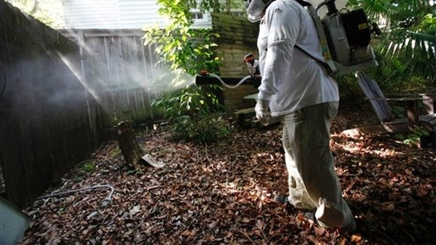 Jason Garcia, a field inspector with the Florida Keys Mosquito Control District, tests a sprayer.