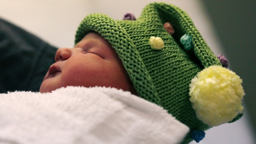 Dec. 12, 2012: Newborn Noelle Joy Klinker, of Reading, Mass., who was born at 12:12 p.m. at the Massachusetts General Hospital, rests in her mother Colleen's arms a few hours after birth.