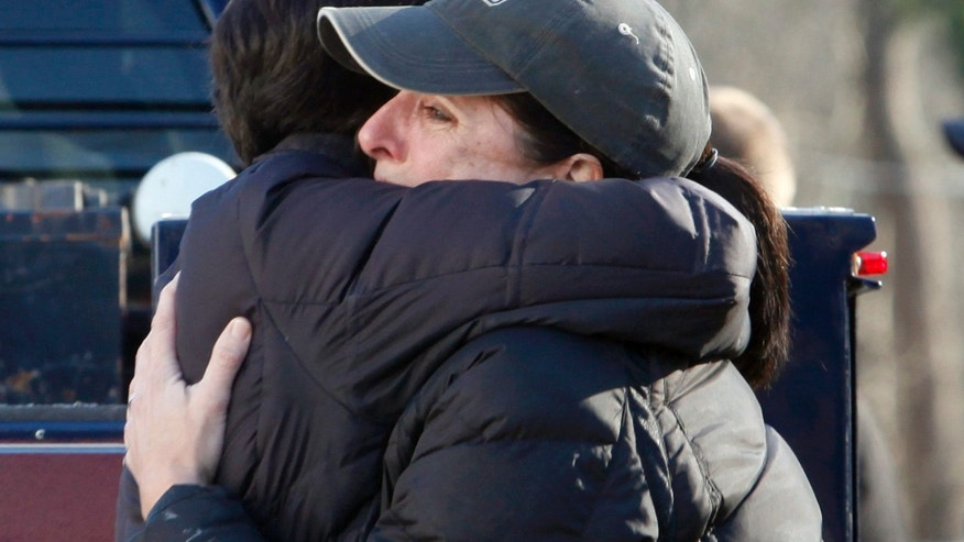 Dec. 14, 2102: Relatives embrace each other outside Sandy Hook Elementary School following a shooting in Newtown, Connecticut.