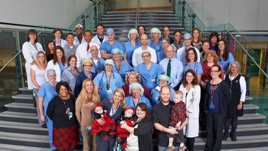 CHOP hospital staff members pose with the Tucker family.