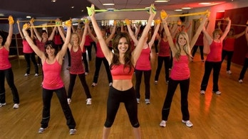 LONDON - JULY 13:  Kelly Brook introduces Reebok and Cirque du Soleil's revolutionary JUKARI Fit to Flex workout with a 'Flex Mob' of 100 women at  on July 13, 2010 in Raynes Park, London. ( Photo by Gary M Prior - Getty Images for Reebok)