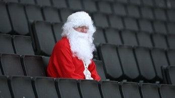 MILTON KEYNES, ENGLAND - OCTOBER 15:  A fan dressed as Santa Claus looks on prior to the npower League One match between MK Dons and AFC Bournemouth at stadiummk on October 15, 2011 in Milton Keynes, England.  (Photo by Pete Norton/Getty Images)