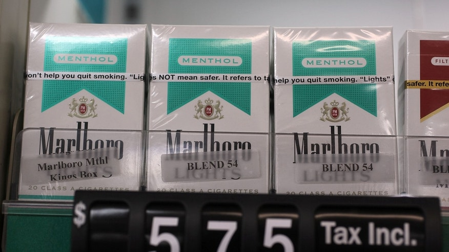 Menthol cigarettes are seen for sale on a shelf at a Quick Stop store in Miami, Florida.