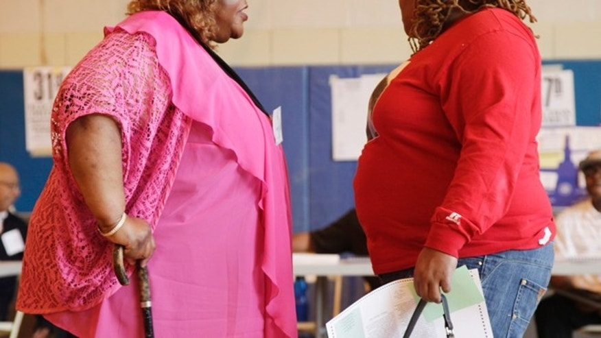 June 26, 2012: In this photo, two overweight women hold a conversation in New York. A new poll suggests that while more than 7 in 10 Americans can correctly tick off heart disease and diabetes as obesity's most serious consequences, few Americans are aware of the lesser-known health consequences.