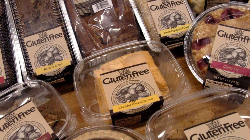 "** FILE ** A sample of some of the 27 gluten-free products are displayed, in this Oct. 5, 2004 file photo, at the Whole Foods Market Gluten-Free Bakehouse in Morrisville, N.C. Each label reads ""Produced in a Dedicated Gluten-Free Facility."" Once banished to the dusty bottom shelves of obscure grocers, the gluten-free revolution is surfacing in the aisles of major supermarkets. (AP Photo/Karen Tam)"