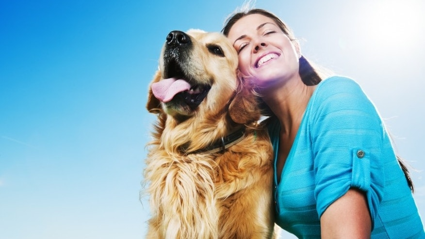Beautiful woman embracing her golden retriever dog against the clear sky.   [url=http://www.istockphoto.com/search/lightbox/9786797][img]http://dl.dropbox.com/u/40117171/people-animals.jpg[/img][/url]  [url=http://www.istockphoto.com/search/lightbox/9786750][img]http://dl.dropbox.com/u/40117171/summer.jpg[/img][/url]
