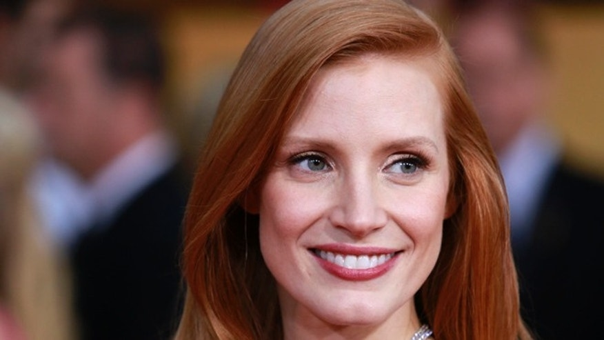 "Actress Jessica Chastain, from the film ""Zero Dark Thirty"" arrives at the 19th annual Screen Actors Guild Awards in Los Angeles."