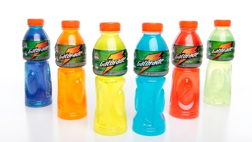 Bottles of Gatorade sports energy isotonic drink contains electrolytes and carbohydrates to rehydrate lost fluids and refuel muscles.  White background.  Flavours are: Fierce Grape, Orange Ice, Lemon-Lime, Blue Bolt, Tropical, Lime Storm.   Editorial use only.