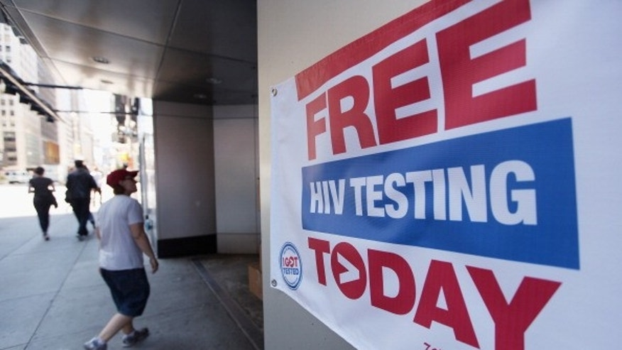 A sign for free HIV testing is seen outside a Walgreens pharmacy in Times Square in New York City.