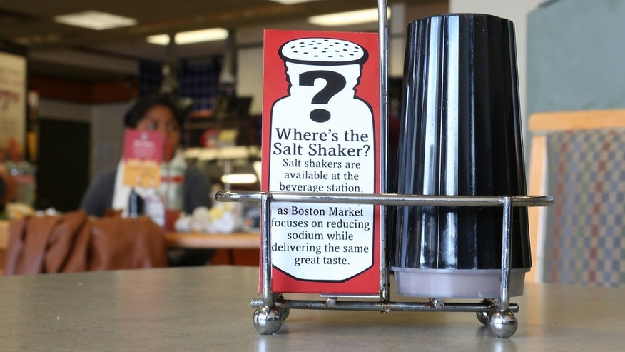 A sign explaining the absence of salt shakers is posted on a table inside a Boston Market restaurant on August 21, 2012 in San Francisco, California. (Photo by Justin Sullivan/Getty Images)