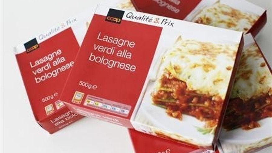 500g size boxes of Coop Qualite & Prix Lasagne Verdi Bolognese are seen after purchase from a Coop supermarket in Zurich, February 12, 2013. The Lasagne Verdi Bolognese contains elements of horsemeat, the company said on Wednesday. REUTERS/Michael Buholzer