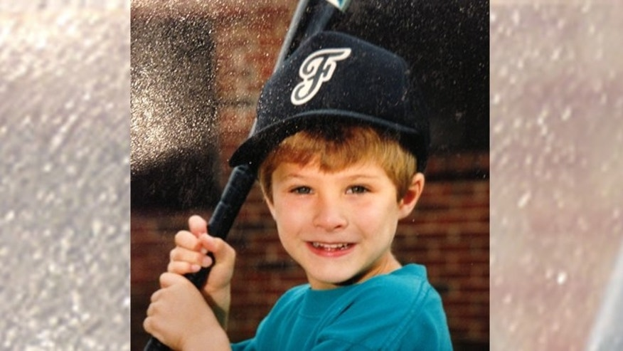 A young Billy Barnhard takes his little league baseball photo before he was diagnosed with generalized dystonia.