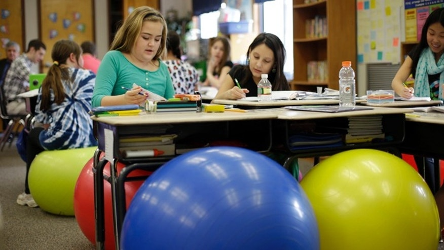 Students in Robbi Giuliano's fifth grade class sit on yoga balls as they complete their assignments at Westtown-Thornbury Elementary School.