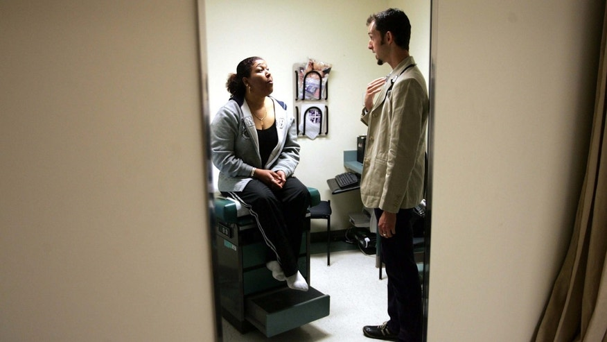 DORCHESTER, MA - APRIL 11:  Dr. Ethan Brackett listens during an examination of patient Cristina Valdez at the Codman Square Health Center April 11, 2006 in Dorchester, Massachusetts. Governor Mitt Romney of Massachusetts is scheduled to sign a health care reform bill April 12 that would make this the first state in the nation to require all its citizens have some form of health insurance.  (Photo by Joe Raedle/Getty Images)