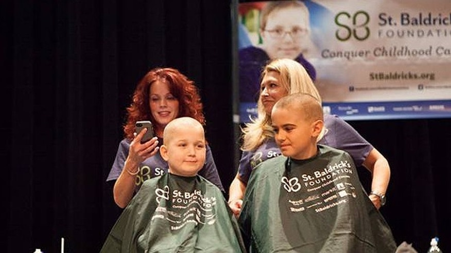 Brent McCreesh, 10, receives a haircut Sunday alongside soccer teammate Timmy Donahue at a 'Team Brent' St. Baldrick's Foundation event to raise money to fight childhood cancer. (Courtesy: Mike McCreesh)