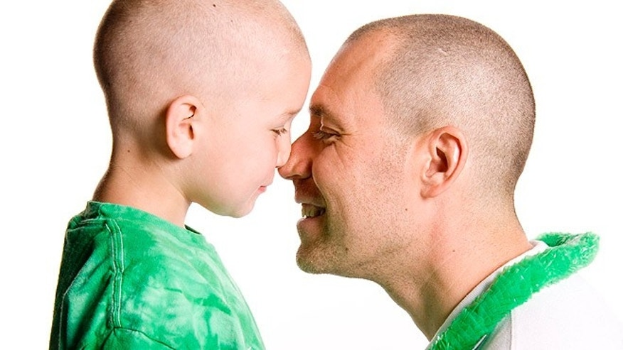 Brent McCreesh, 10, with his father, Mike McCreesh, who was recently named to the board of directors at the St. Baldrick's Foundation, which has raised more than $150 million to fight childhood cancer since its inception. (Courtesy: Mike McCreesh)