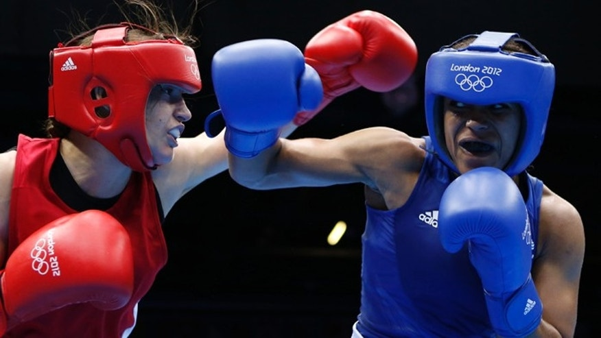 Ireland's Katie Taylor (L) fights Britain's Natasha Jonas during their quarterfinal Women's Light (60kg) boxing match at the London Olympic Games.