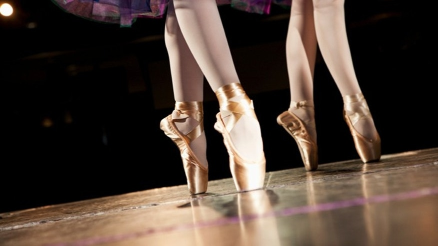 Ballet dancers performing en pointe.