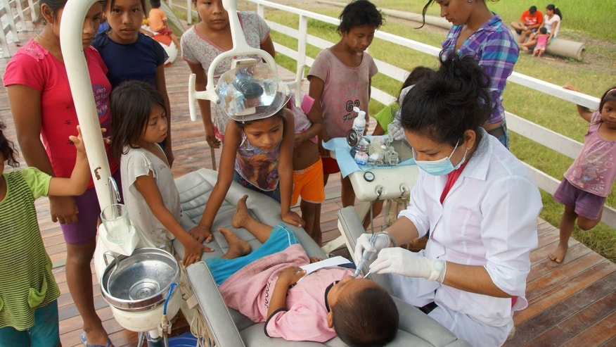 A child is treated on the Apus Boat.