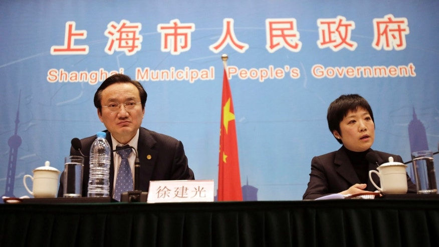 Xu Jianguang, Director-General and Deputy Secretary of the CPC Committee of Shanghai Municipal Health Bureau, left, and Wu Fan,  Chief Doctor and Director General of Shanghai Municipal Center for Disease Control, right attend a press conference in Shanghai, China. Shanghai activated an emergency response plan following the recent deaths of two men from a lesser-known strain of bird flu.