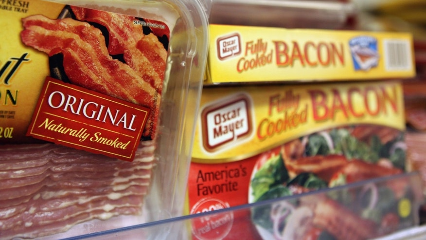 SAN RAFAEL, CA - AUGUST 17:  Packages of bacon are displayed on a shelf at United Market August 17, 2010 in San Rafael, California. As Americans consume more bacon, supplies have become short and the price is starting to go up. The price of pork bellies has risen to $1.40 a pound in August, up from 94 cents a pound in June.  (Photo by Justin Sullivan/Getty Images)