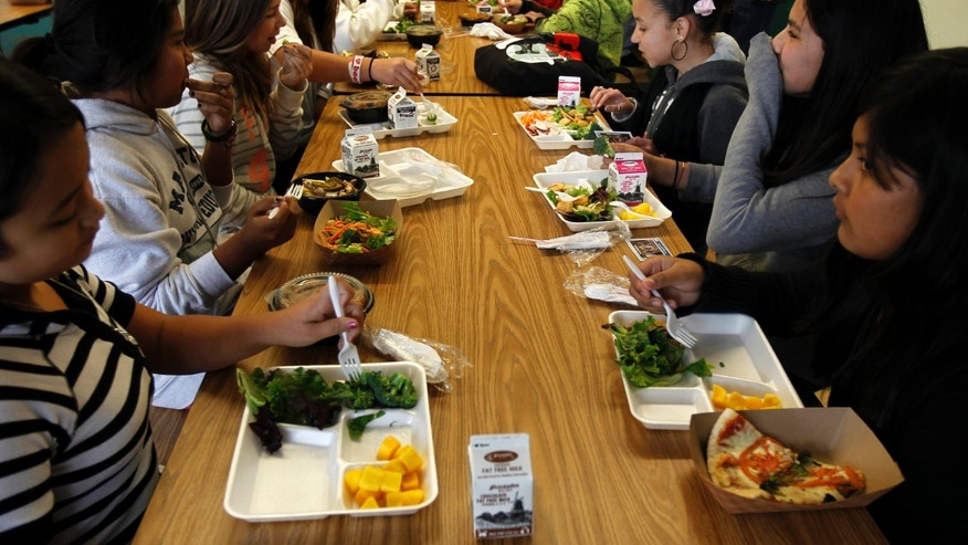 Students sit down to eat a healthy lunch at Marston Middle School in San Diego, California.