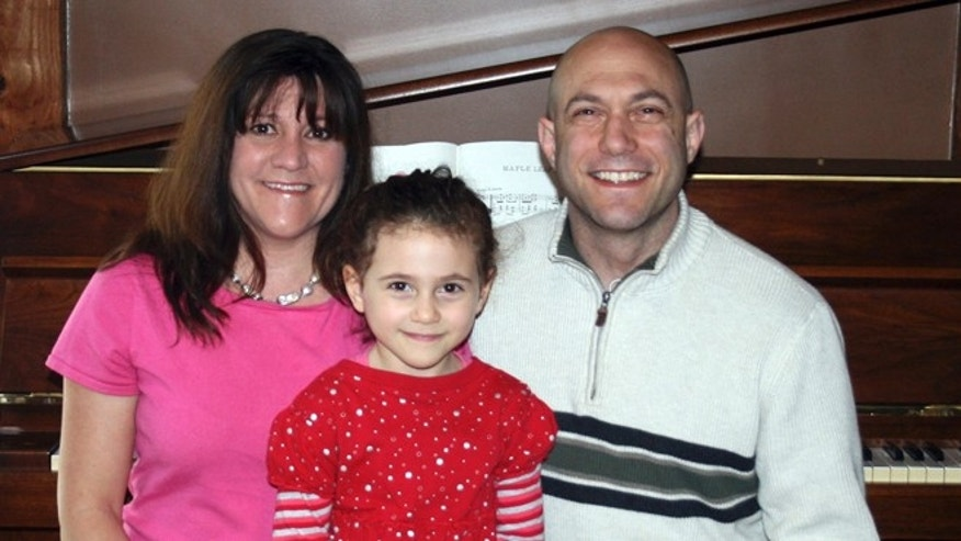 This undated photo provided by the Avielle Foundation shows Jeremy Richman, Jennifer Hensel and their daughter Avielle, 6, who was killed in the shooting massacre by Adam Lanza at Sandy Hook Elementary School in Newtown, Conn., on Dec. 14, 2012.  (AP Photo/The Avielle Foundation)
