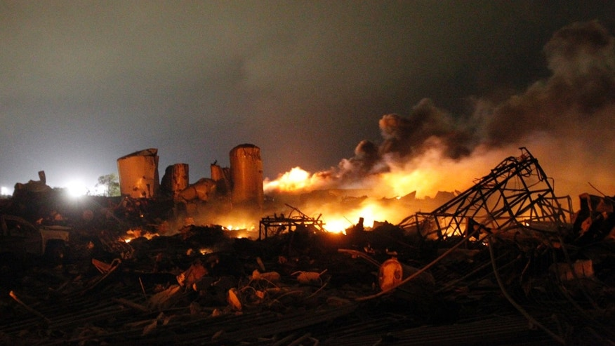 The remains of a fertilizer plant burn after an explosion at the plant in the town of West, near Waco, Texas early April 18, 2013. The deadly explosion ripped through the fertilizer plant late on Wednesday, injuring more than 100 people, leveling dozens of homes and damaging other buildings including a school and nursing home, authorities said.