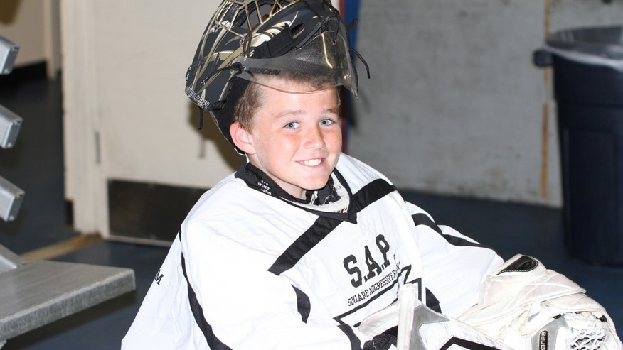 Connor McMahon in his hockey gear.
