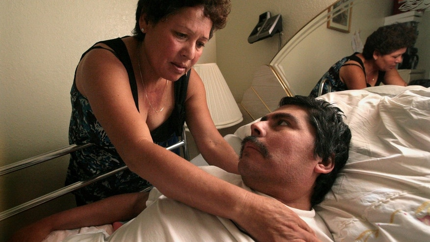 In this Oct. 13, 2008 photo, Lucila Huerta, tends to her husband Guadalupe, who is suffering from Valley Fever and other medical problems, in their apartment in Madera, Calif.  Valley Fever, a little-known disease infecting more people nationwide every year, is especially prevalent in Californias San Joaquin Valley. Every day millions of residents in this agricultural region live with the threat of the disease, which is caused by a fungus in the soil. People who work in dusty fields or construction sites are most at risk, but even visitors passing through the valley can contract Valley Fever.  (AP Photo/The Fresno Bee, John Walker)