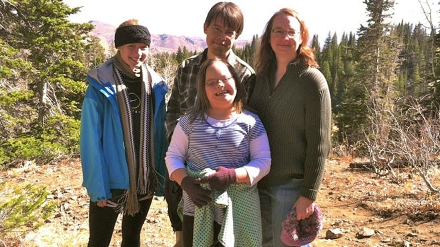 Ellie, Laura, George and Theresa Estreich pose for the camera during a recent family trip to Utah.