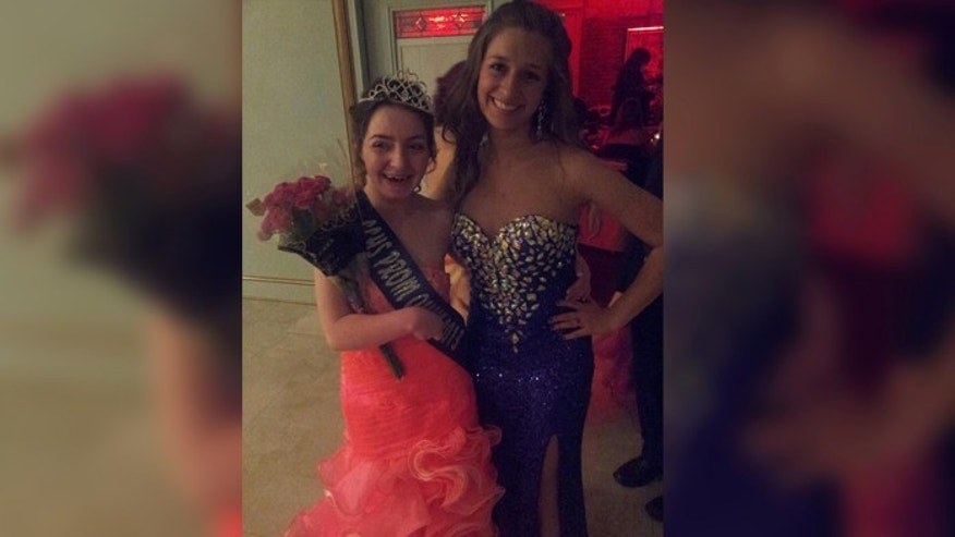 Desaray Carroll posing with her friend after being crowned Prom Queen.