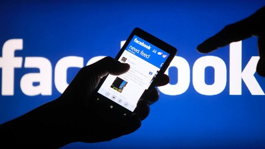 May 2, 2013: A smartphone user shows the Facebook application on his phone in the central Bosnian town of Zenica.
