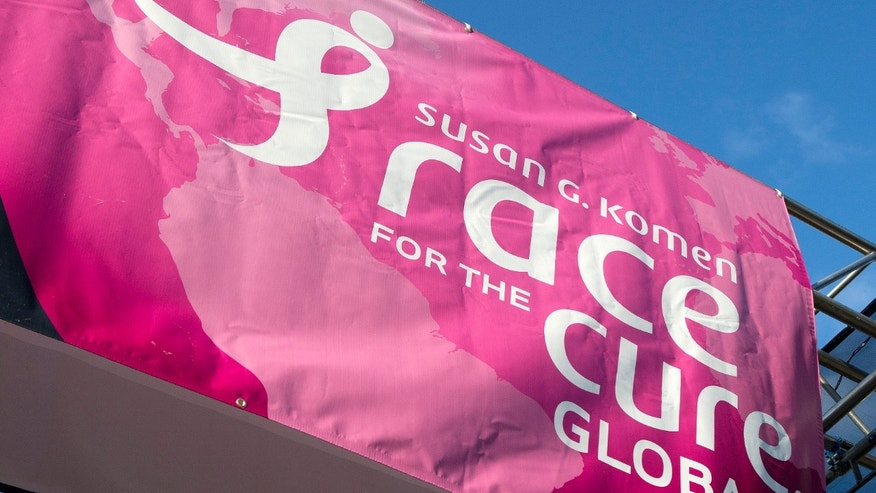 A sign for the Susan G. Komen Foundation's 2012 Race for the Cure is displayed in Washington.