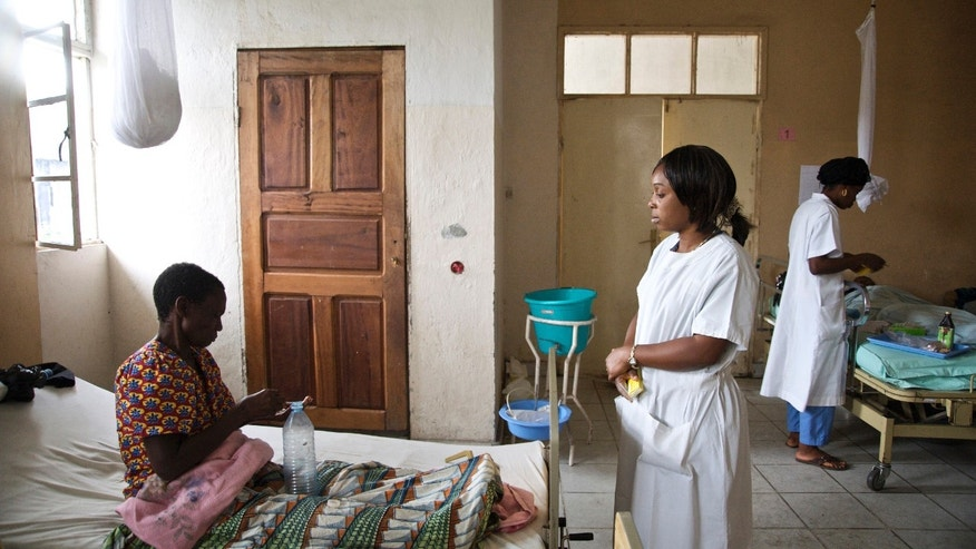 Nurses administer medication to women who have recently undergone their fistula repair surgeries as a result of severe sexual violence, in Goma.
