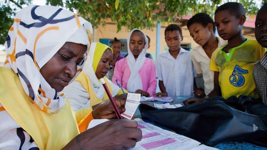 Children register for a meningitis vaccination at the School for Midwives in El Daein, East Darfur.
