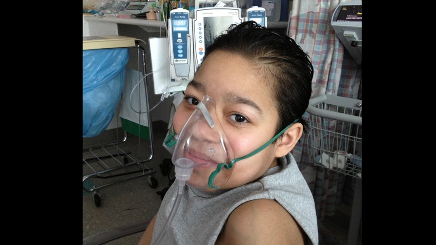 Javier Acosta, 11, of New York, who has cystic fibrosis and is in intensive care.
