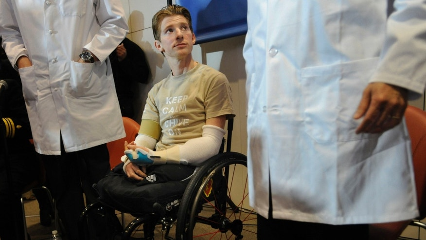 In this Tuesday, Jan. 29. 2013, photo, retired Infantryman Brendan M. Marrocco participates in a news conference at Johns Hopkins hospital in Baltimore. Marrocco received a transplant of two arms from a deceased donor after losing all four limbs in a 2009 roadside bomb attack in Iraq.