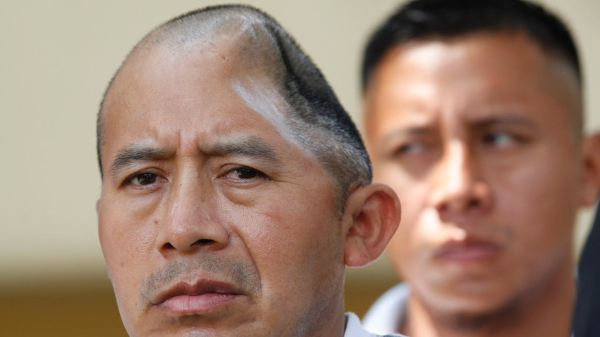 Antonio Lopez Chaj, left, a 43-year-old house painter, appears with his brother, Pedro Chang, right, at a news conference in Los Angeles.