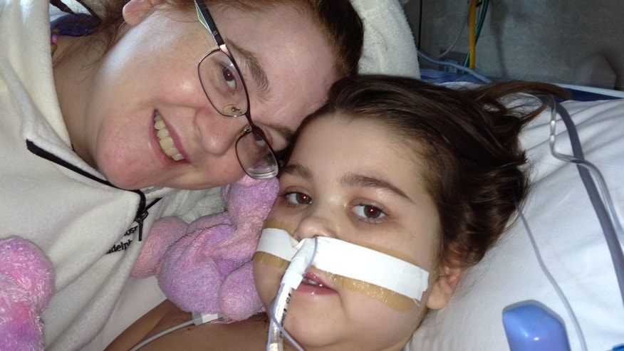 Sarah Murnaghan (R) with her mother, Janet (L), on June 28, 2103, one week after her second surgery.