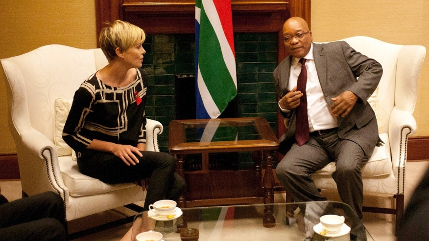 South African President Jacob Zuma, right, meets South African-born Hollywood actress Charlize Theron, left, at his Union Building office in Pretoria, South Africa, ahead of their meeting, to discuss the fight against HIV and AIDS.