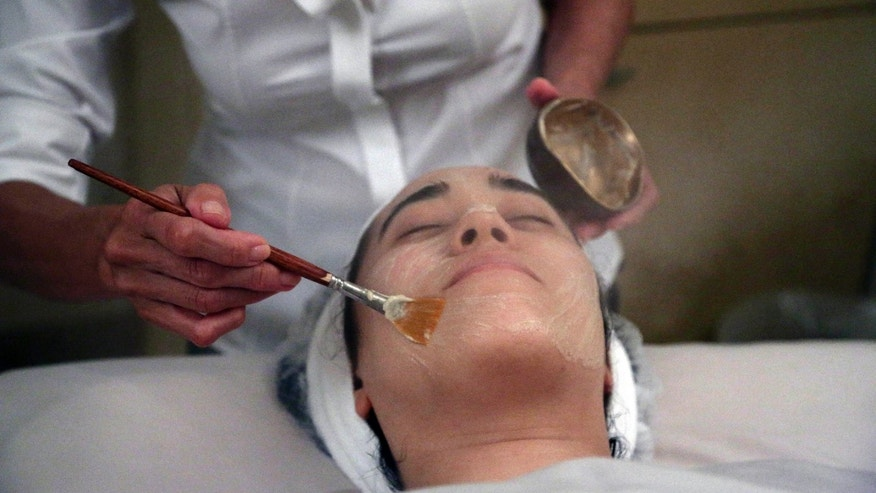 Salon owner Shizuka Bernstein gives what she calls a Geisha Facial to Mari Miyoshi at Shizuka New York skin care in New York.