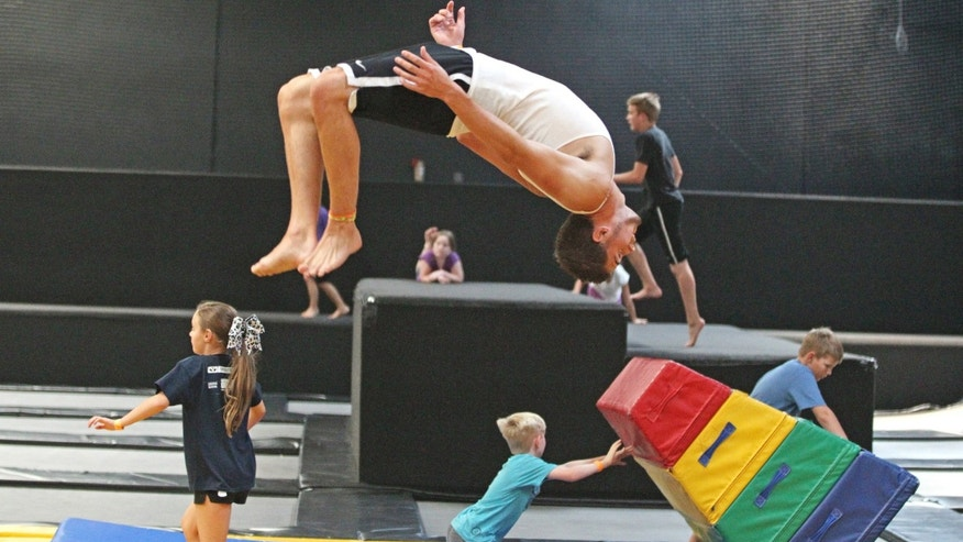 Jacob Terrell, of Pleasantville, flips as others play at the Get Air Hang Time indoor trampoline park in Orem, Utah. (AP Photo/Rick Bowmer)